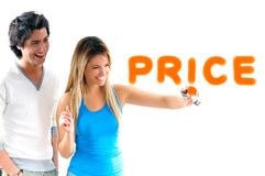 Man and blond girl writing discount prices. Man and woman writing a message with sprayer Royalty Free Stock Photography