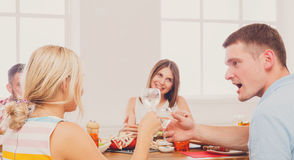 Man and blond woman at dinner table, party for friends Royalty Free Stock Photo