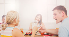 Man and blond woman at dinner table, party for friends Stock Image