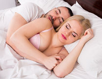 Man and blond woman sleeping Royalty Free Stock Photos