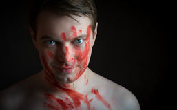Man with blood on his face. Royalty Free Stock Photography