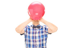 Man blowing a balloon Royalty Free Stock Image