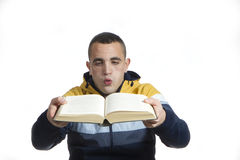 Blowing a book Stock Photo