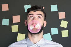 Man blowing bubble with gum royalty free stock image