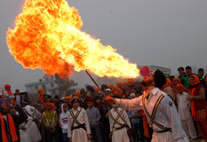 Man blowing fire. A man blowing fire from its mouth. these men are the follower of guru Gobind Singh (the 10th lord of Sikh community). this road show is done on Royalty Free Stock Image