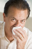 Man Blowing His Nose royalty free stock photography