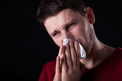 Man blowing his nose Stock Image