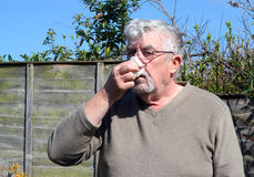 Man blowing his nose. Stock Images
