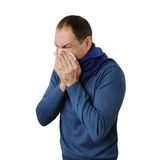 Man blowing his nose isolated on white Stock Image