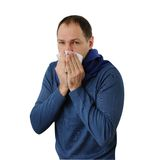 Man blowing his nose isolated on white Royalty Free Stock Photo