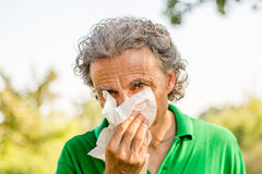 Man blowing his nose Stock Images