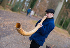 Man blowing horn Royalty Free Stock Photo