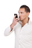 Man blowing a kiss into his mobile phone Stock Photography