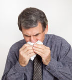 Man Blowing Nose Closeup Stock Photo