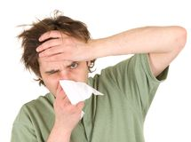 Man blowing nose with handkerchief Royalty Free Stock Images