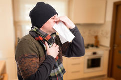 Man blowing nose because of illness. And having respiratory problems Royalty Free Stock Photos