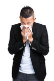 Man blowing nose Stock Image