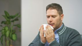 Man blowing nose to napkin. Handsome unshaved man blowing nose to napkin stock footage