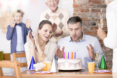 Man blowing out candles Stock Photography