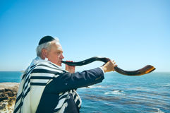 Man Blowing Shofar, High Holidays Stock Photo