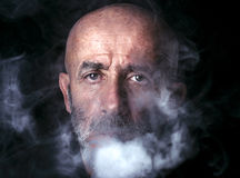 Man blowing smoke Stock Photography