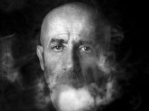 Man blowing smoke Royalty Free Stock Photo
