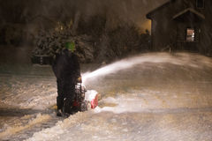 Man blowing snow Stock Photography