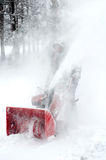 Man blowing snow with machine Stock Image