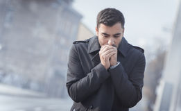 Man blowing in their hands Stock Photo