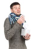 Man blowing into tissue and pulling tissues from box. Stock Photography