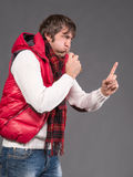Man blowing a whistle and pointing Stock Photos