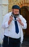 Man Blowing Yemenite shofar royalty free stock image