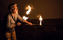 Man Blows Fire Into the Night. A Man Blows Fire Into the Night in the suburbs Royalty Free Stock Photos