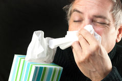 Man Blows Nose Stock Photography