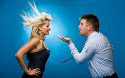 Man blows on the woman Stock Photos