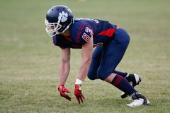 Man in Blue American Football Suit on Green Grass Field Royalty Free Stock Photos