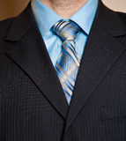 Man in blue business suit detail. stock images