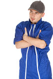 Man in blue coveralls and baseball cap Royalty Free Stock Photography