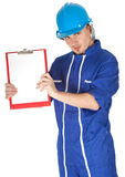 Man in blue coveralls with blank clipboard Stock Photography