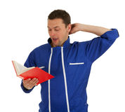 Man in blue coveralls with book Stock Photo
