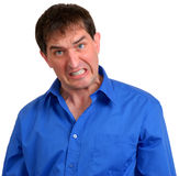 Man in Blue Dress Shirt 3. Man in blue dress shirt angrily baring his teeth stock image