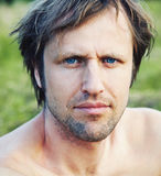 Man with blue eyes Stock Images