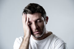 Man with blue eyes sad and depressed looking lonely and suffering depression feeling sorrow Stock Images