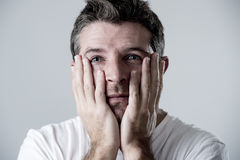 Man with blue eyes sad and depressed looking lonely and suffering depression feeling sorrow Stock Photography