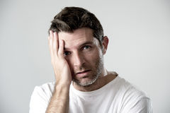 Man with blue eyes sad and depressed looking lonely and suffering depression feeling sorrow Royalty Free Stock Image