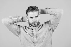 Man in blue fashionable shirt. Man with bearded face and stylish haircut. Fashion model in casual shirt. Fashion style. And trend. Skincare and hair care in royalty free stock photos