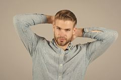 Man in blue fashionable shirt. Man with bearded face and stylish haircut. Fashion model in casual shirt. Fashion style. And trend. Skincare and hair care in royalty free stock photo