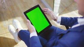 Man in blue formal attire watching video on tablet. During a break. Bank employee relaxing at work. App, Green screen stock video footage