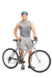 Man with a blue helmet posing behind his bike Stock Images