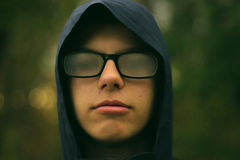 Man in Blue Hoodie With Black Framed Sunglasses Stock Photo